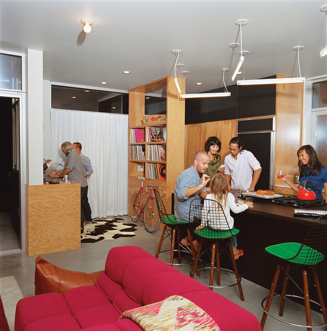 The resident wanted to be able to use the space as a fun gathering place for parties, so Bestor set a DJ booth at the edge of the kitchen. Custom plywood shelving holds vinyl records.