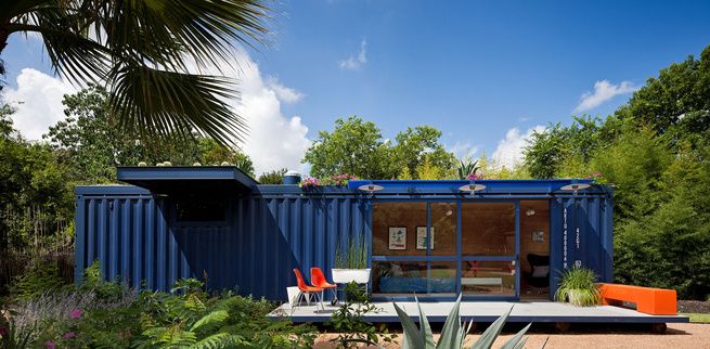 While shopping for containers, Hill was instantly drawn to this one's existing blue color and chose to buy it and leave it as is. Poteet added floor-to-ceiling sliding doors to allow light in, as well as a cantilevered overhang to shade a window on the le