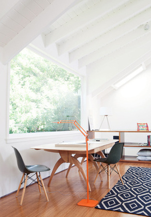 Modern space with Heywood Wakefield table and kilim rug