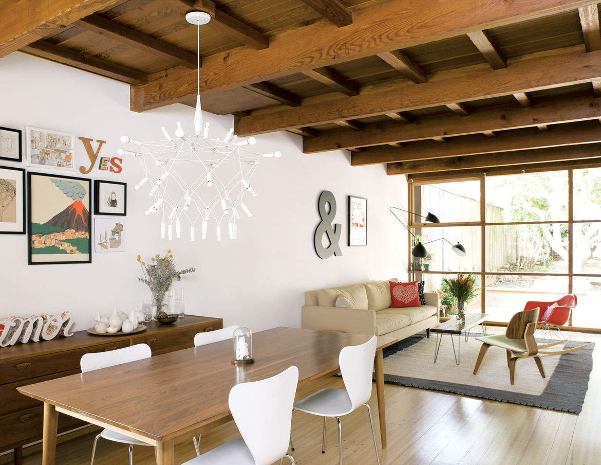 Level headed exposed wooden rafters living room
