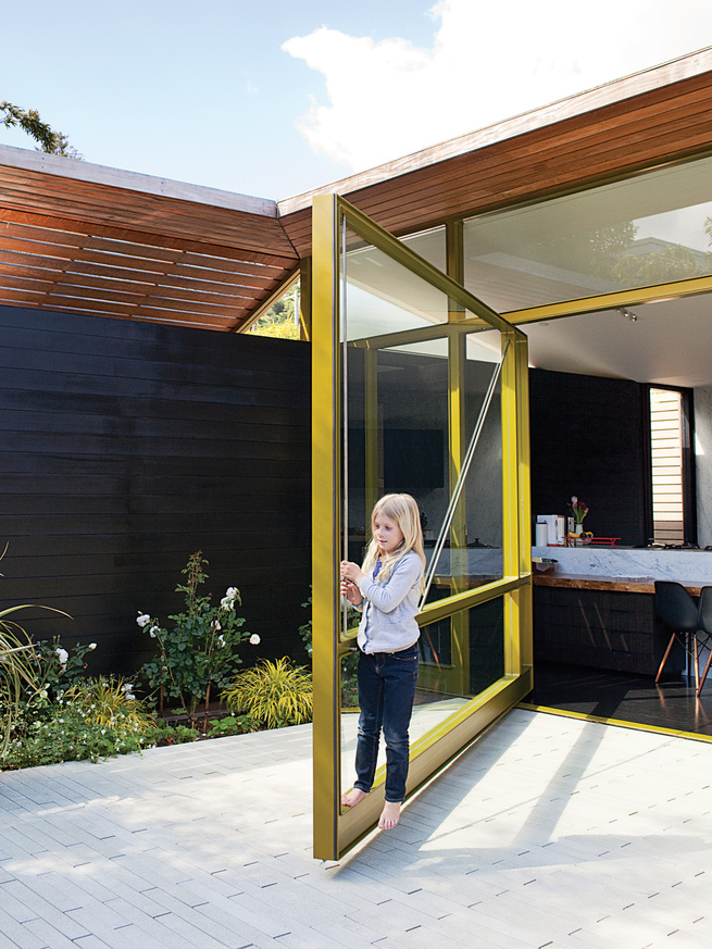 Yellow glass-and-steel door engineered by Sand Studios