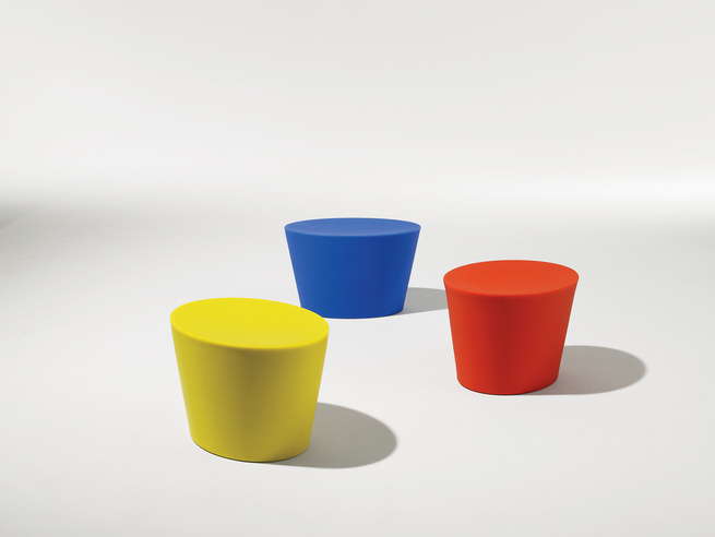 Multi-colored cylindrical outdoor seating.