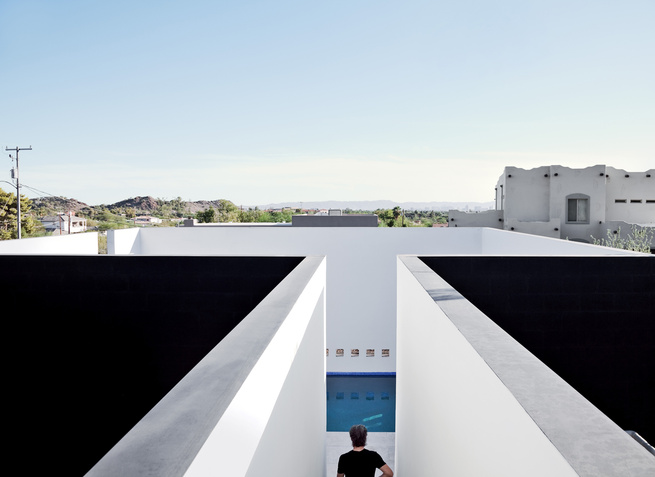 White plaster walls surrounding pool.