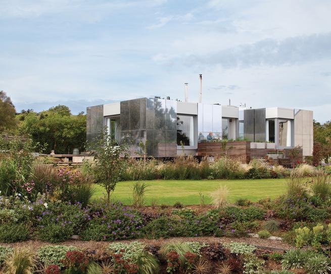 Landscape home facade with sliding aluminum panels