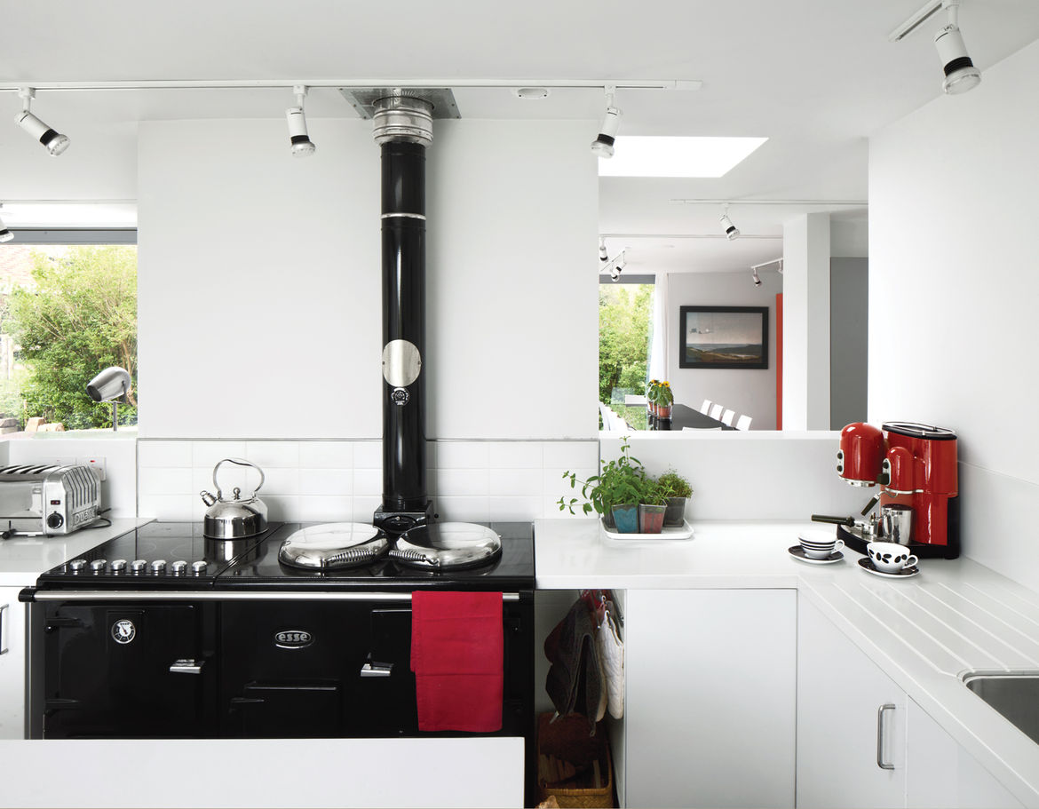 Modern green kitchen with solar-powered stove