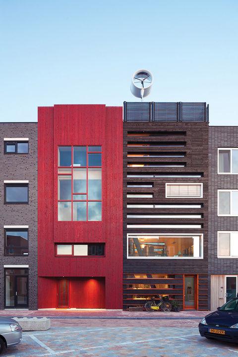 Amsterdam modern house facade charred wood