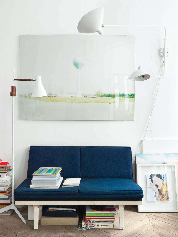 Modern blue sofa in white living room.