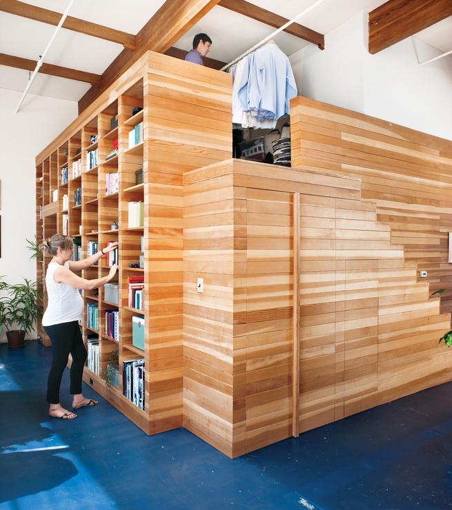 interior beniot residence bookshelf portrait