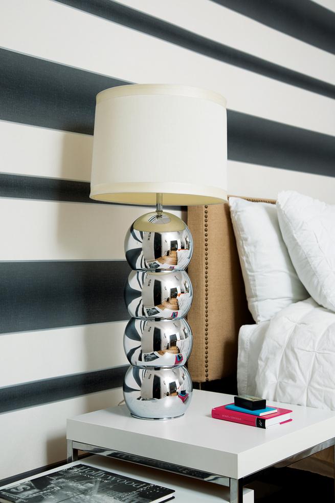 Vintage chrome lamp on bedside table.