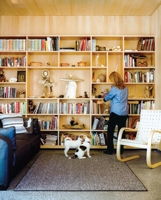 Modern bookshelf area and Alvar Aalto lounge chair