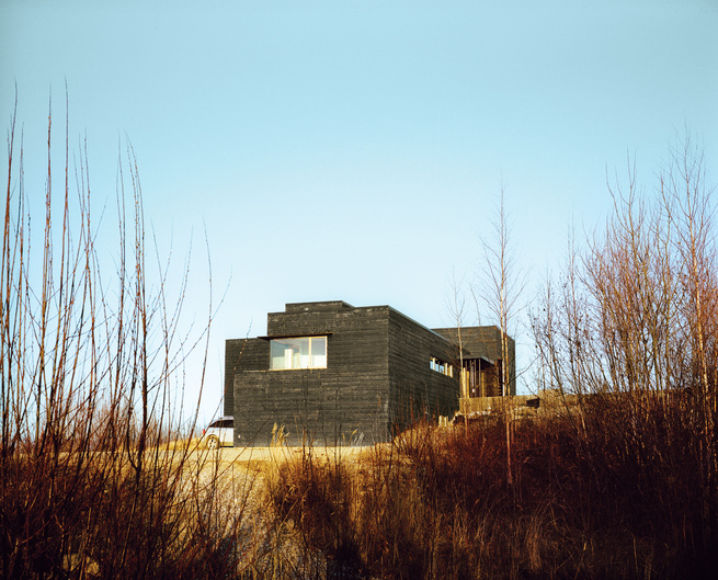 Exterior view of charred cedar cabin