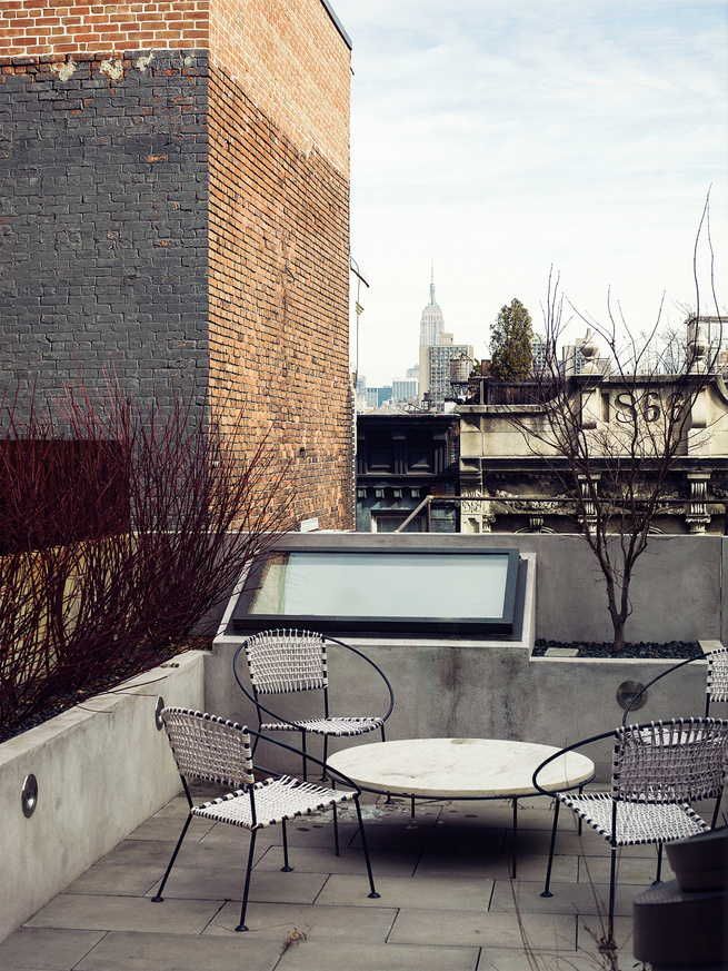 Visible skylights on outdoor roof terrace.