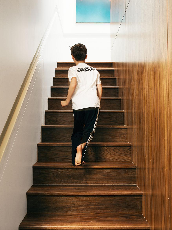 Custom walnut stairwell.