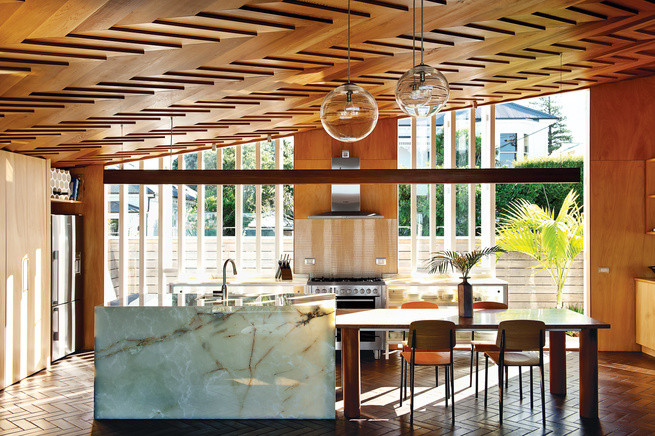 Modern dining room with wooden herringbone patterned ceiling