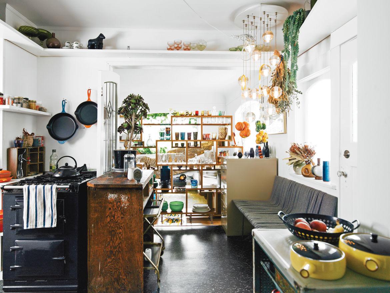 Modern open plan kitchen with Omer Arbel furniture