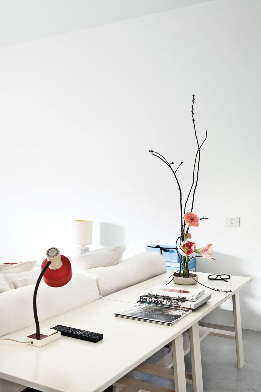 Modern master bedroom with vintage red light