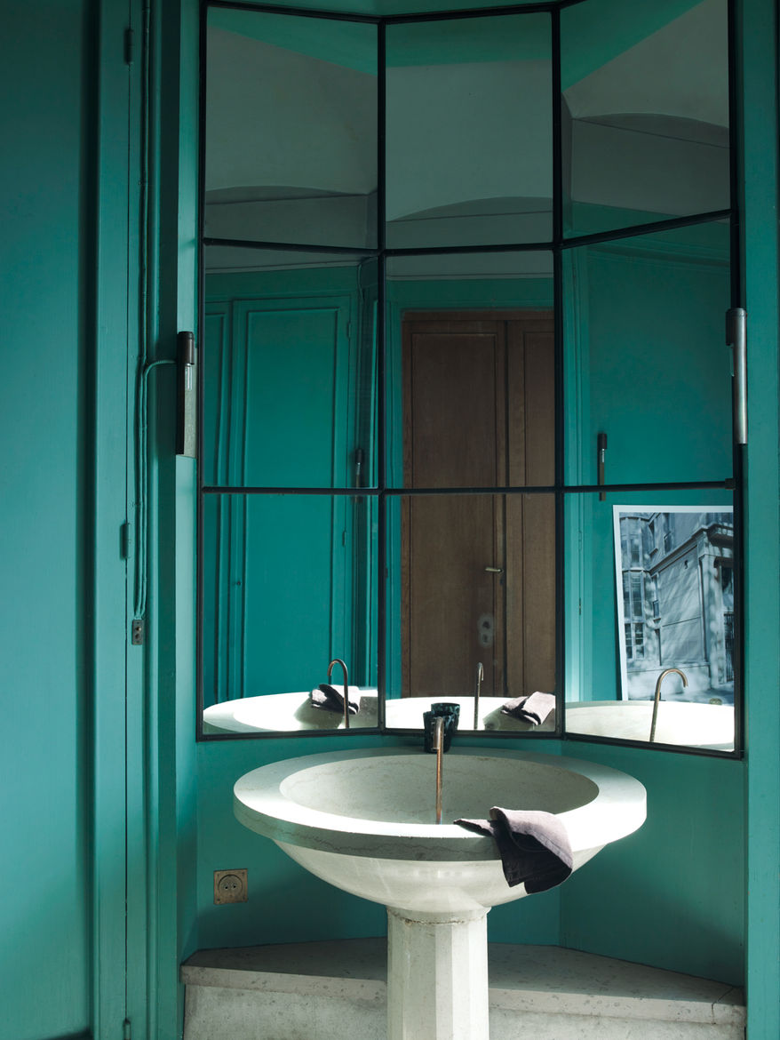 Modern bathroom with green blue walls and multiple windows