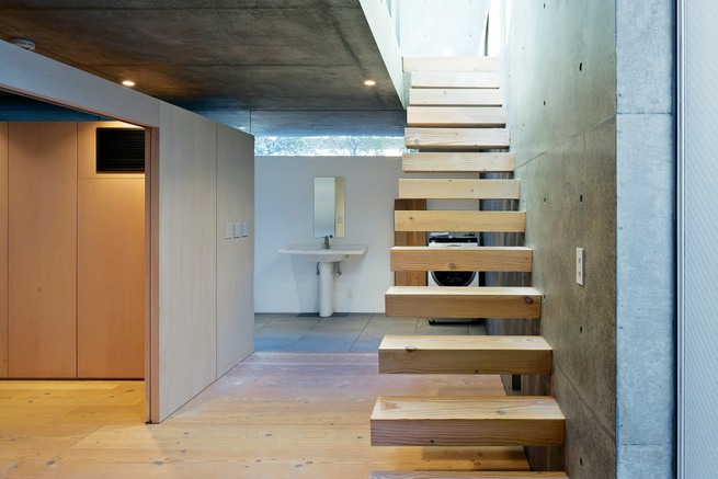 open plan concrete home in japan staircase