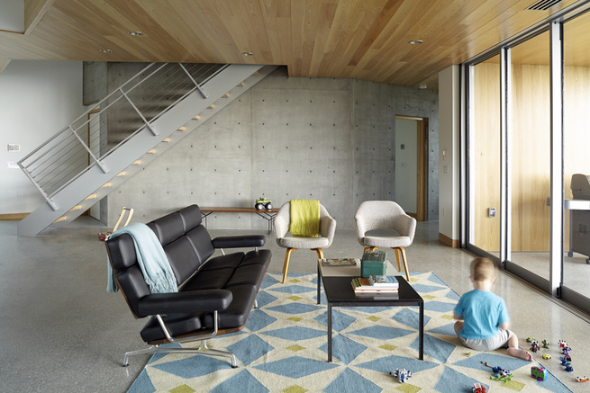 Traction Architecture beach house Florida concrete hurricane proof living room Bertoia Knoll Saarinen