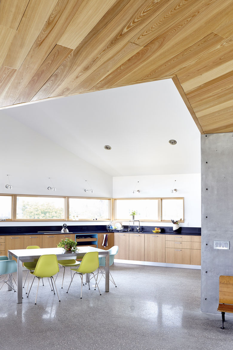 Traction Architecture beach house Florida concrete hurricane proof Paperstone countertops kitchen