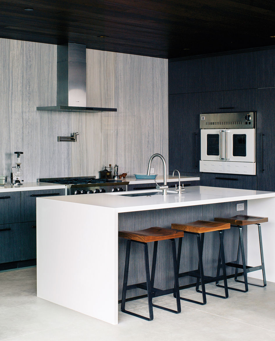 open kitchen with earthy color scheme
