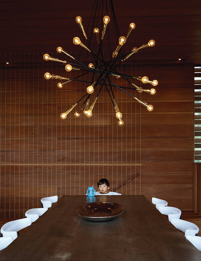 Dining room with Sputnik-style chandelier and oxidized maple table