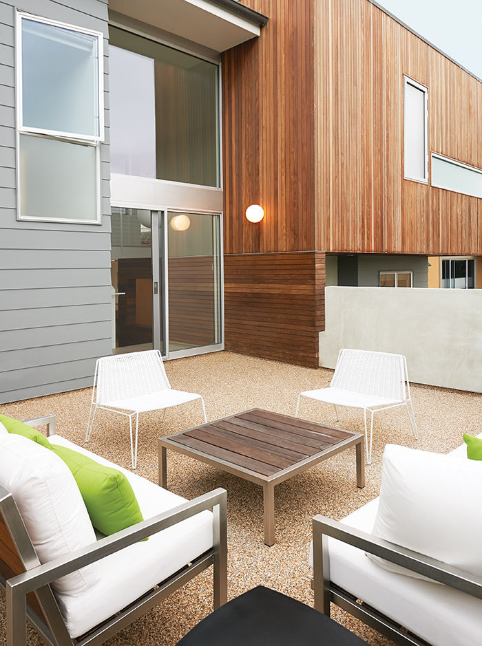 California house with deck and seating and wood table