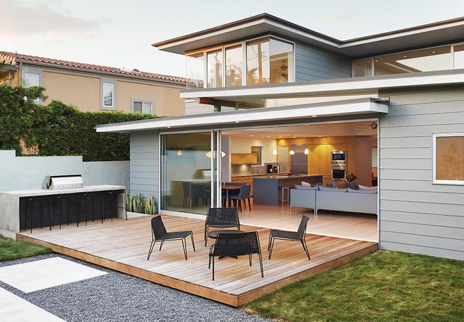 California backyard wooden deck and concrete bar and sliding glass door