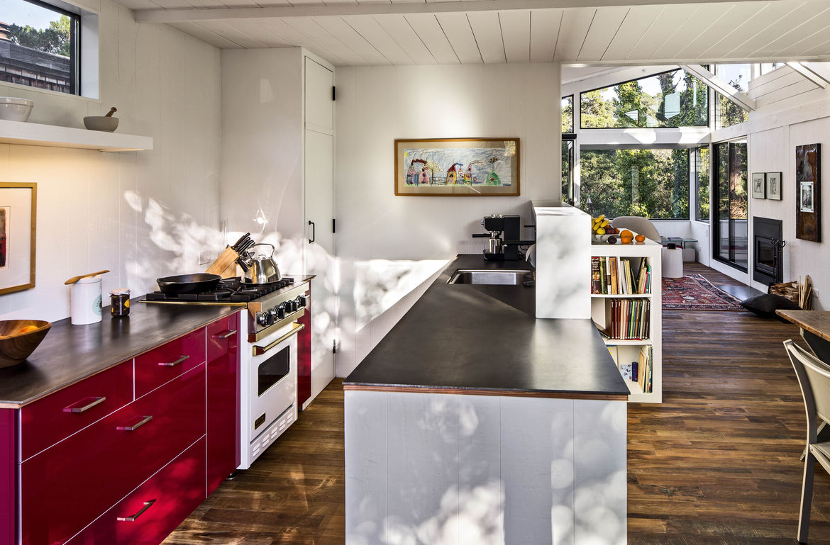 Torres Residence kitchen with red cabinetry.