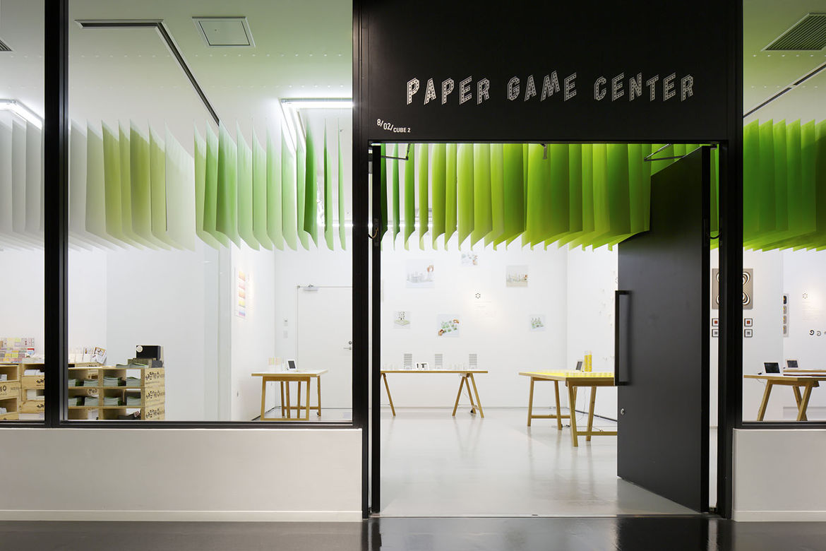 Installation with hanging panels in shades of green