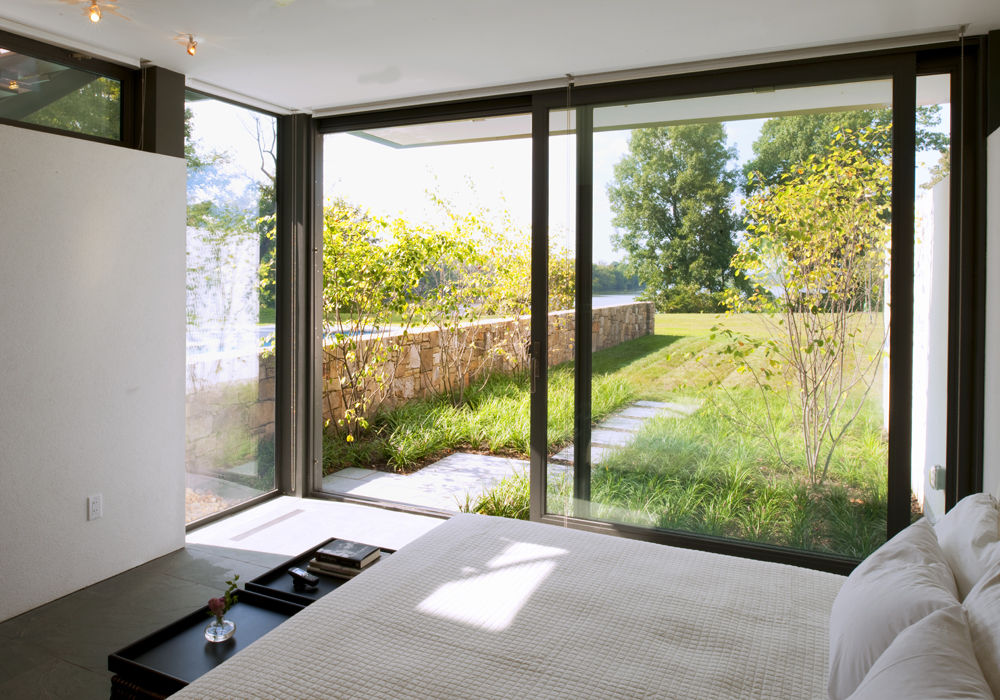 Guest suite with sliding glass doors leading to garden