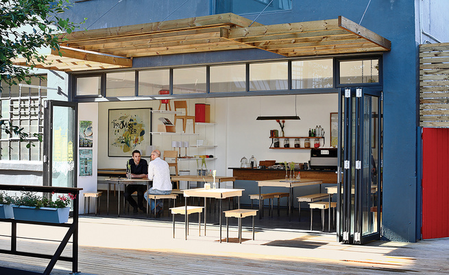 Field Office coffee shop exterior with wood overhang and tables