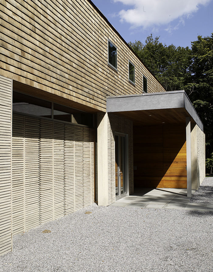 Garage of Hamptons house with wooden horizontal stakes