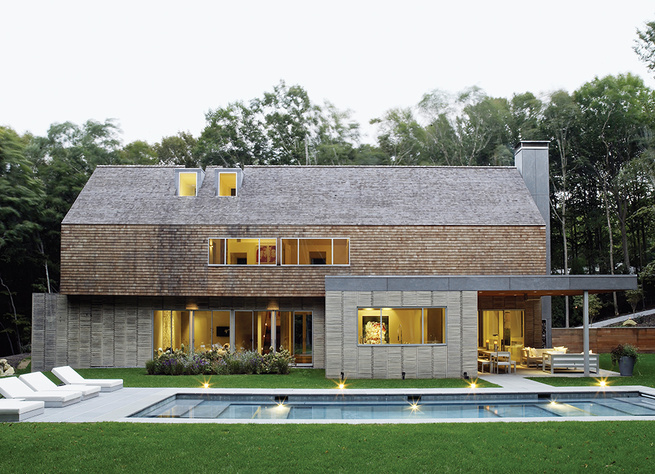 Hamptons modern pool off gabled house with cedar paneling