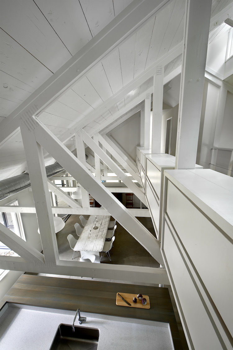 The exposed trusses and steep roof create a spacious interior