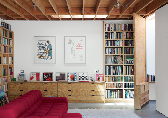 Family room with hinged tall door and bookcases