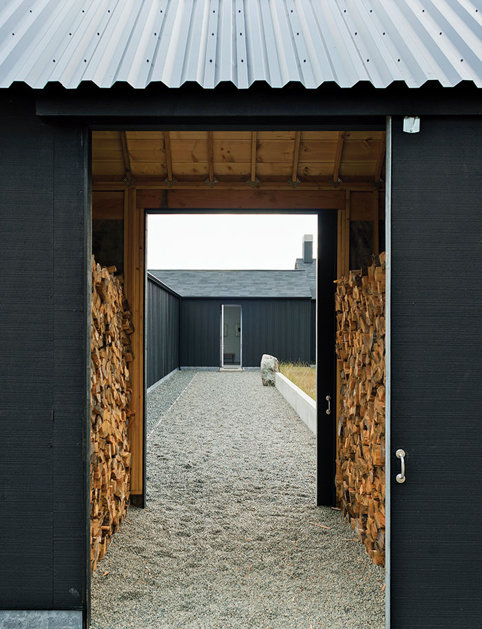 Gravel path leading to firewood storage and front door in Washington