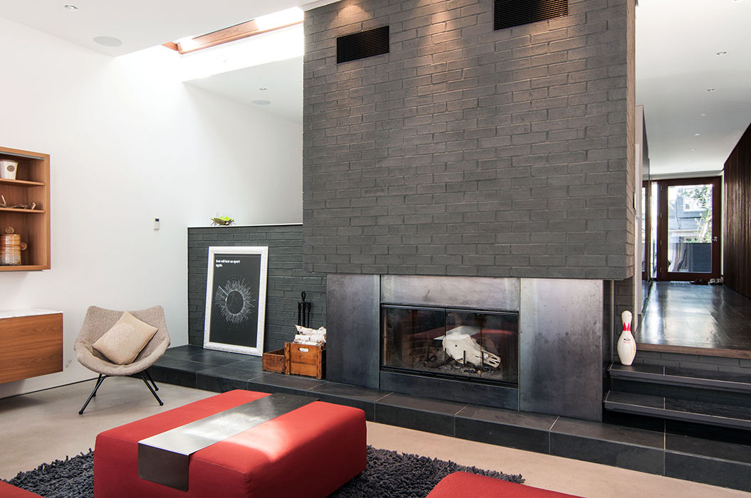 Toronto living room with masonry chimney and wood-burning fireplace