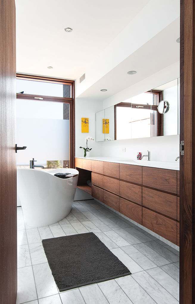 Modern bathroom with bathtub and cedar window