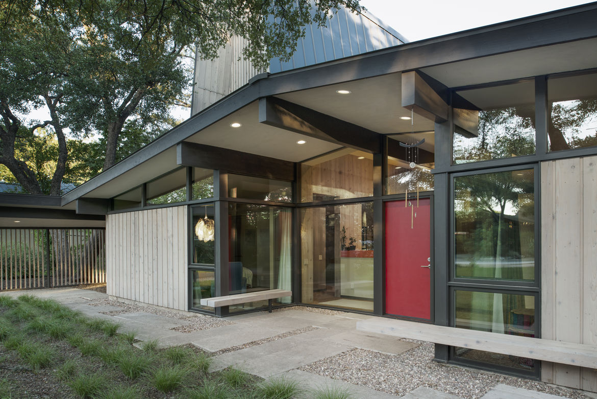 Japanese-inspired home with floor-to-ceiling windows and red front door