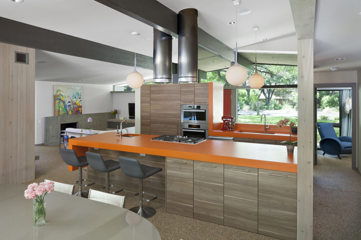 Midcentury renovated kitchen with orange countertops