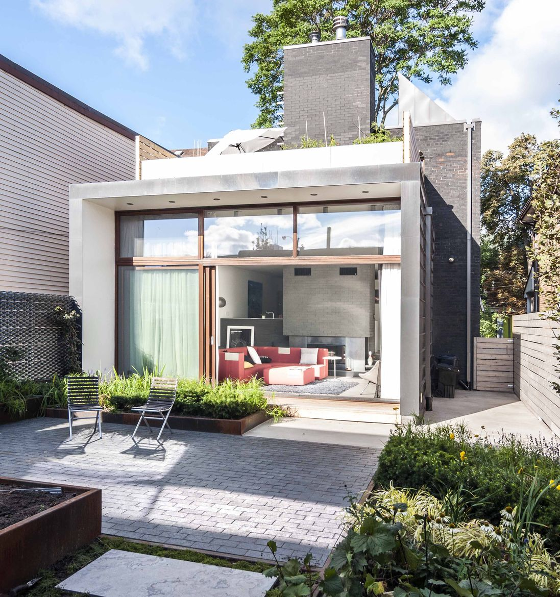 New Toronto addition with garden and roof terrace