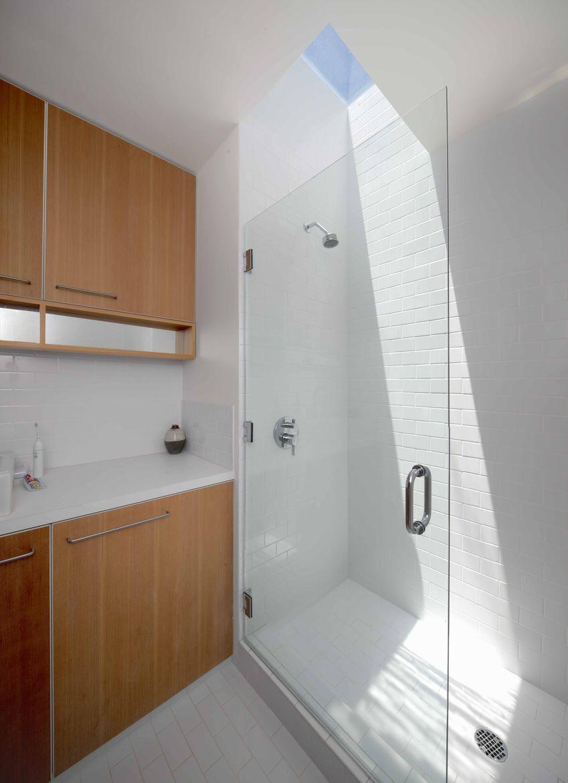 Modern bathroom with skylight and glass door
