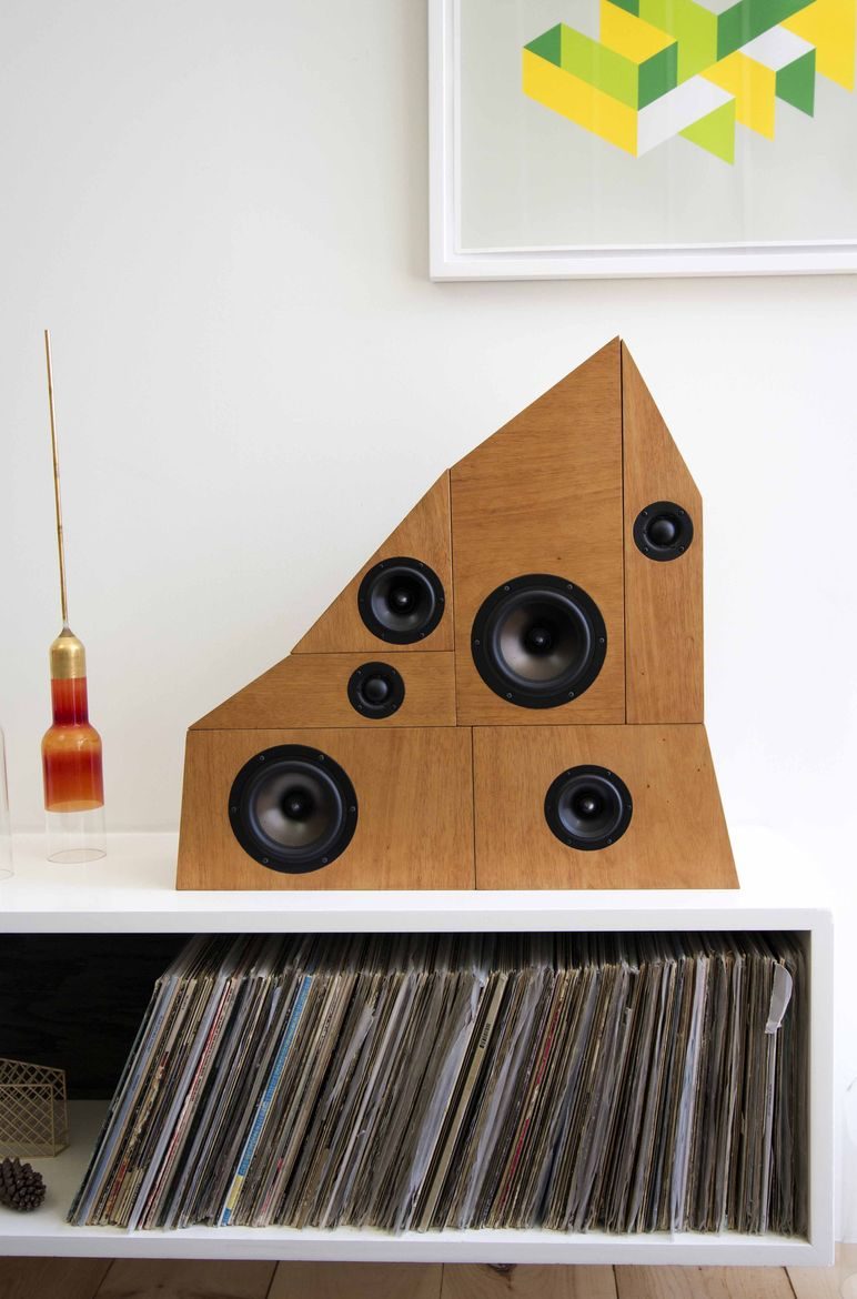 Wooden speaker stack with record collection.