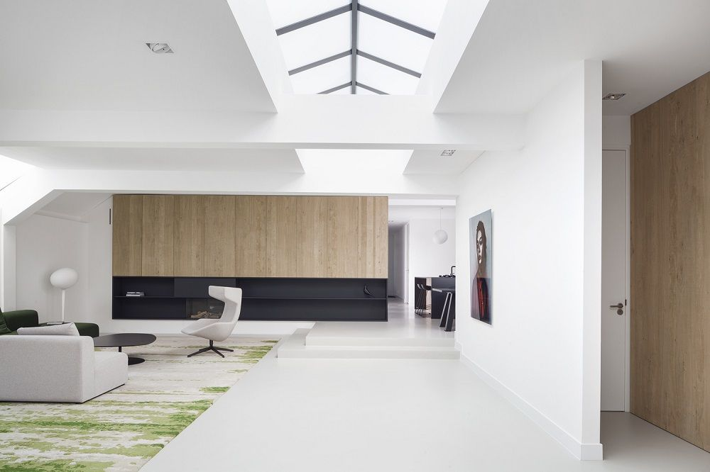 Open-plan living space in Amsterdam with skylight and white walls