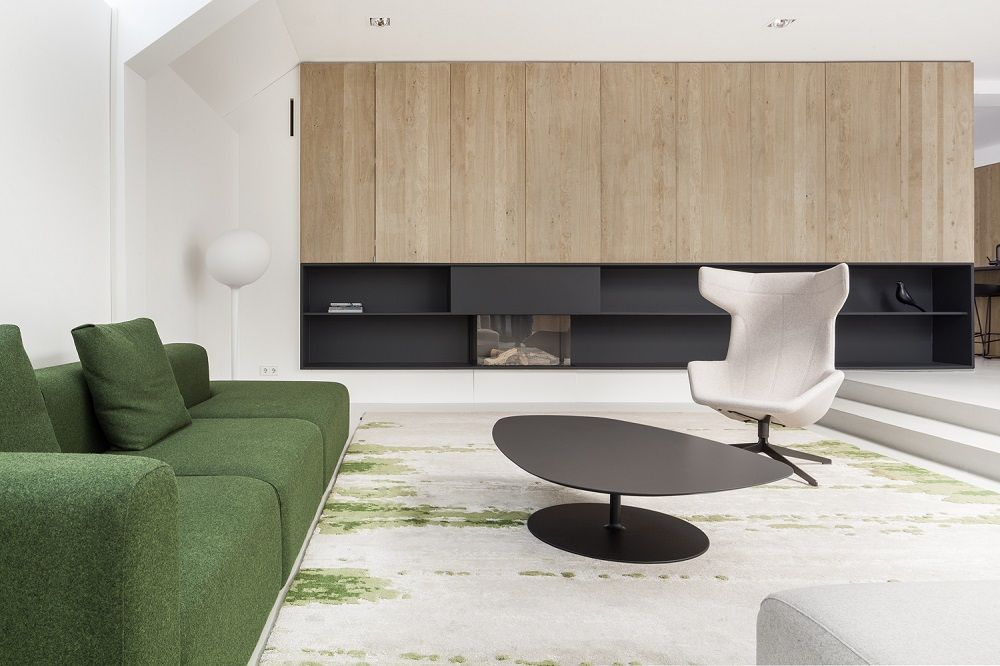 Amsterdam renovation with minimal interiors and furniture by Hay, Moroso, and Flos