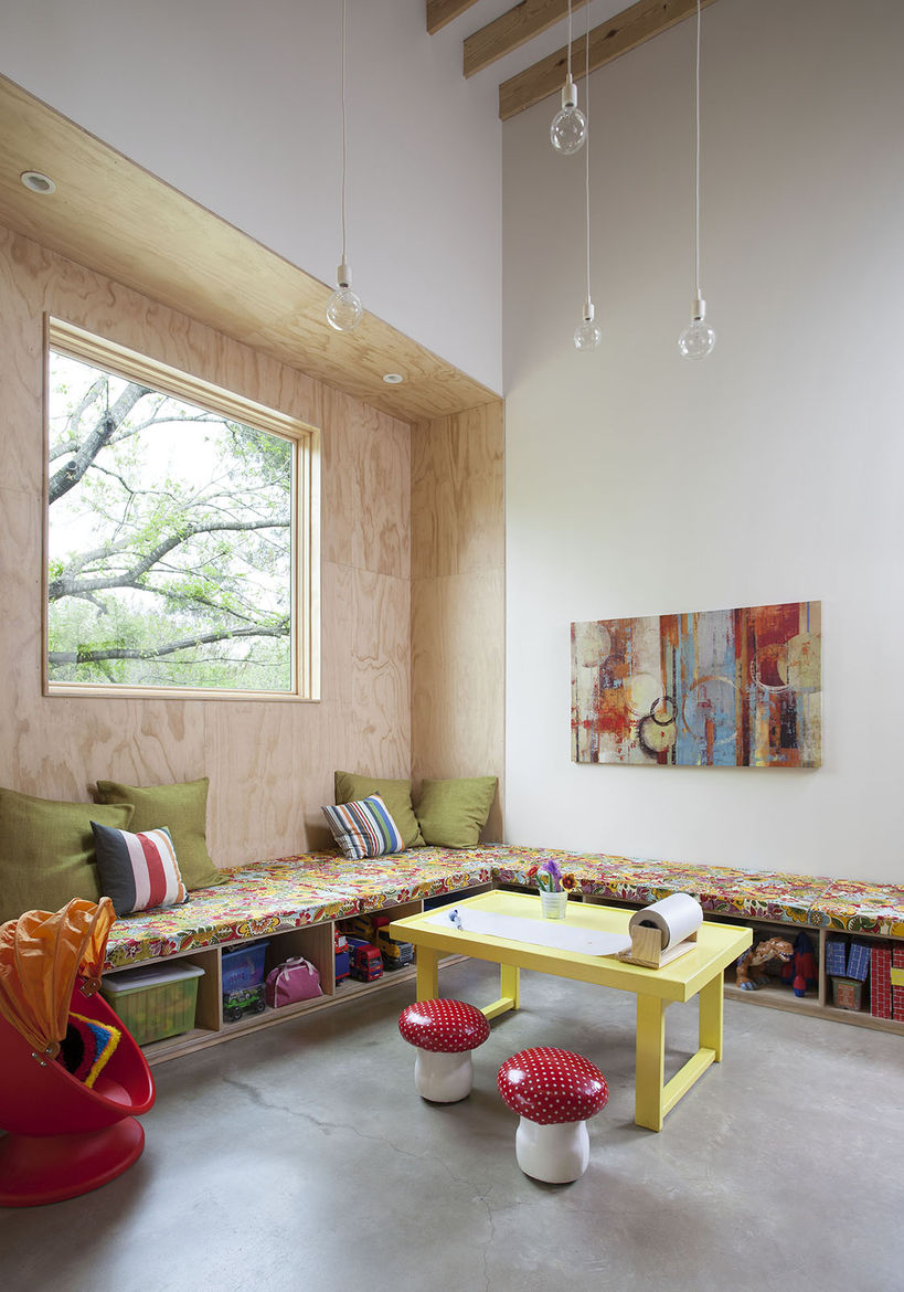 playroom with yellow table and built-in benches