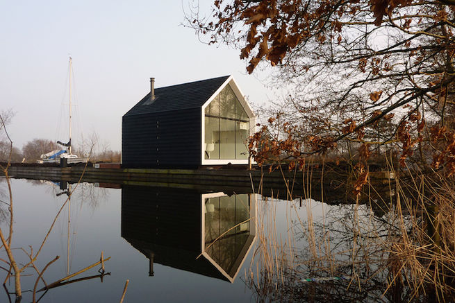 The Island House Prefab Cabin exterior by 2by4 Architects