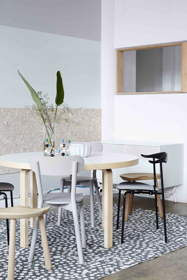 Dots office area with Artek table and variety of modern seating