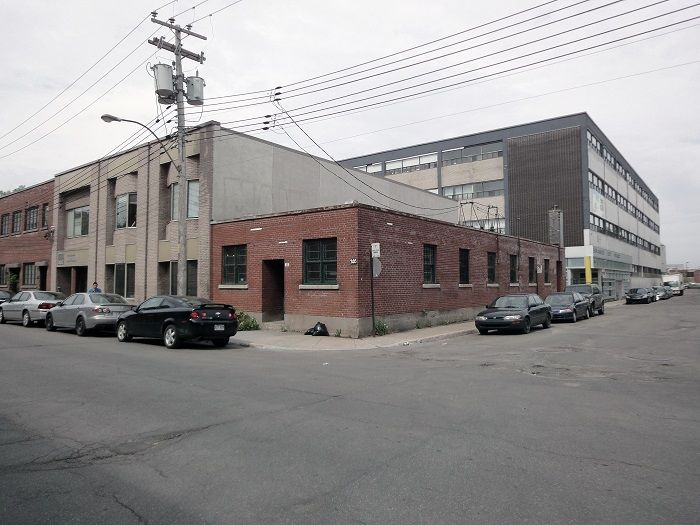 Le 205 Industrial Renovation brick facade by Atelier Moderno
